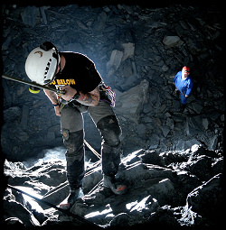 Caver abseiling into a large cavern